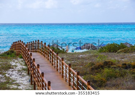 Wooded bridge and turquoise sea, Cayo Largo, Cuba - stock photo