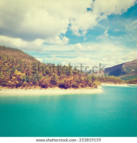 Wooded Shore of the Lake in French Alps, Instagram Effect - stock photo