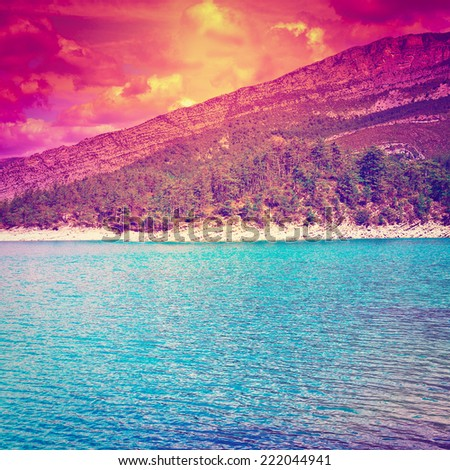 Wooded Shore of the Lake in French Alps, Sunset, Instagram Effect - stock photo
