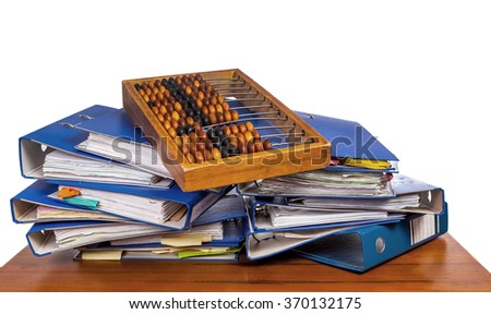 Wooden abacus on pile of an office folders over white background - stock photo