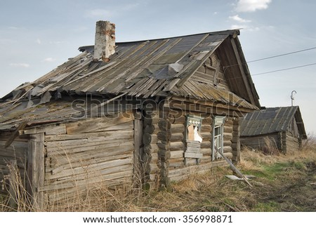 Wooden abandoned old house with the driven-in windows in Preobrazhenskoe. Tyumen region. Russia - stock photo