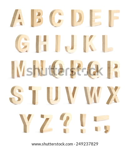 Wooden ABC alphabet set with punctuation marks, composition isolated over the white background - stock photo