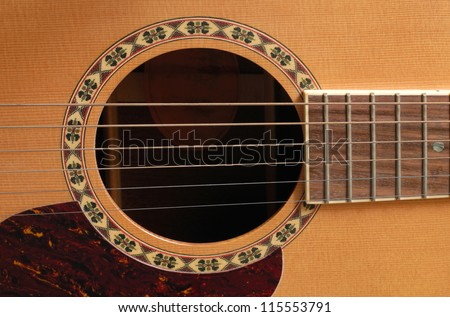 wooden acoustic guitar - stock photo