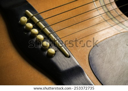 wooden acoustic guitar bar. detail of classic guitar. - stock photo