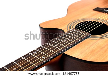 Wooden acoustic guitar isolated closeup horizontal - stock photo