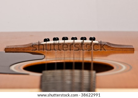 Wooden Acoustic guitar isolated on white background