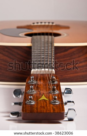 Wooden Acoustic guitar isolated on white background - stock photo