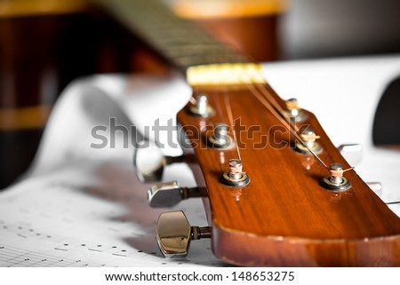 Wooden Acoustic guitar with song note paper - stock photo