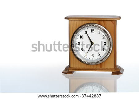 Wooden alarm clock isolated on white background with clipping path