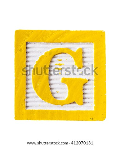 Wooden alphabet block with letter G isolated on white