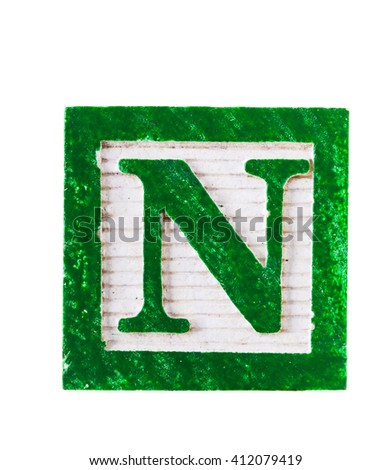 Wooden alphabet  block with letter N isolated on white - stock photo