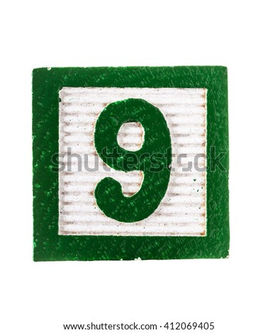 Wooden  alphabet block with number 9 isolated on white - stock photo
