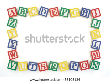 Wooden alphabet blocks arranged to create an horizontal frame isolated on a white background. Clipping path. - stock photo