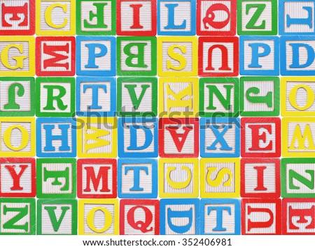 Wooden alphabet blocks background - stock photo