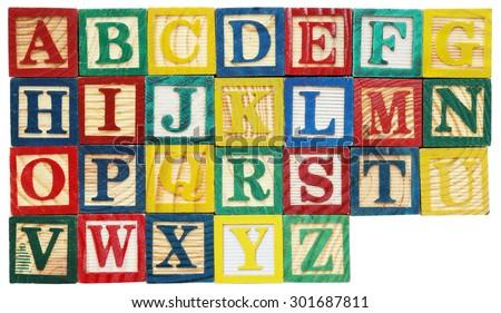 Wooden alphabet blocks isolated on white - stock photo