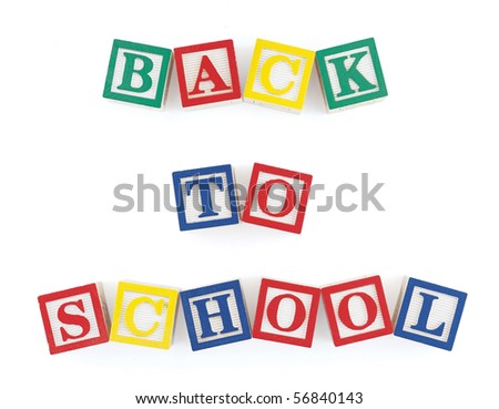 Wooden alphabet blocks on  white arranged to form the words, 'back to school' - stock photo