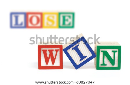 "Wooden alphabet blocks on white spelling, ""win"" in front row. Further back and out of focus, are blocks spelling the word,  ""lose"". Isolated on white."