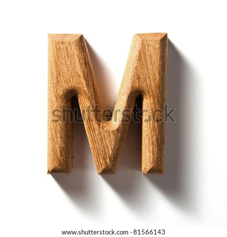 Wooden alphabet letter with drop shadow on white background, M - stock photo