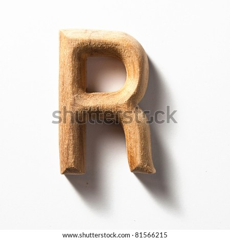 Wooden alphabet letter with drop shadow on white background, R - stock photo
