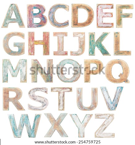 Wooden alphabet letters isolated on white - stock photo