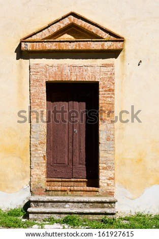 Wooden Ancient Italian Door in Historic Center - stock photo