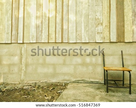 wooden and cement background with old chair for texture,vintage tone