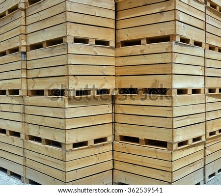 Wooden Apple boxes stacked ready for harvest time in the middle of Summer - Motueka, New Zealand.