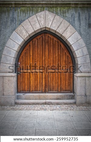 Wooden arched doors from the town hall building in Helsingborg, Sweden. - stock photo