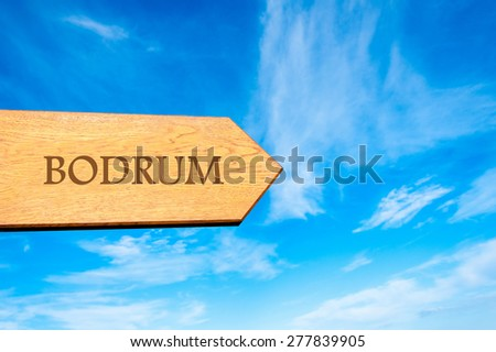 Wooden arrow sign pointing destination BODRUM, TURKEY against clear blue sky with copy space available. Travel destination conceptual image - stock photo