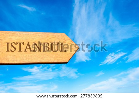 Wooden arrow sign pointing destination ISTANBUL, TURKEY against clear blue sky with copy space available. Travel destination conceptual image - stock photo