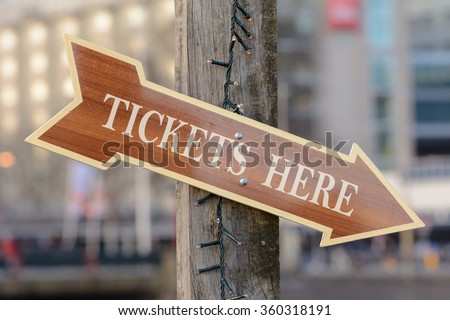 Wooden arrow sign, tickets here!