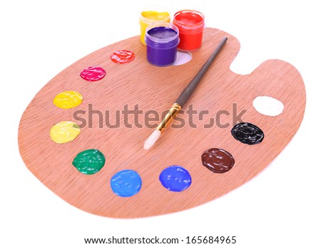 Wooden art palette with paint and brush isolated on white