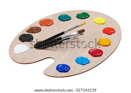 Wooden art palette with paints and brushes, isolated on white background - stock photo