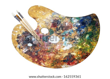 Wooden art palette with paints and brushes (path) - stock photo