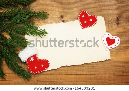 Wooden background: Blank Old Paper Sheet with Christmas tree and  felt handmade decorations on wooden background  - stock photo