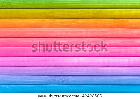 Wooden background from multicoloured boards.