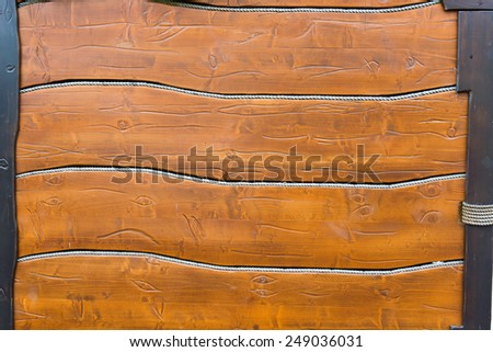 wooden background, horizontally positioned boards and rope - stock photo