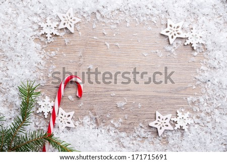 wooden background with artificial snow - stock photo