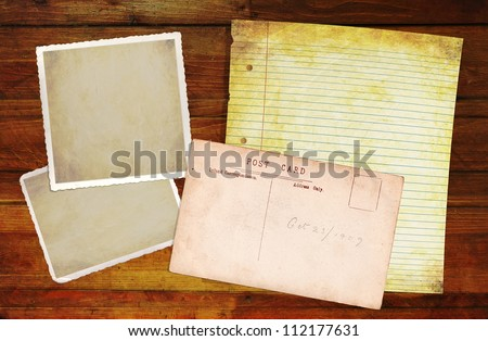 Wooden Background with blank old notepaper and photo blanks for your own content. - stock photo