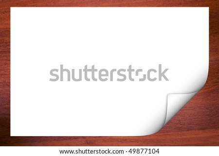 wooden background with blank paper - stock photo