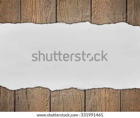 Wooden background with empty text space made of torn paper - stock photo