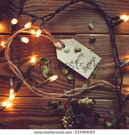 wooden background with festive garland lamps.new year ready still life.merry christmas - stock photo