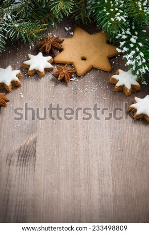 wooden background with fir branches and cookies, selective focus, vertical photo - stock photo