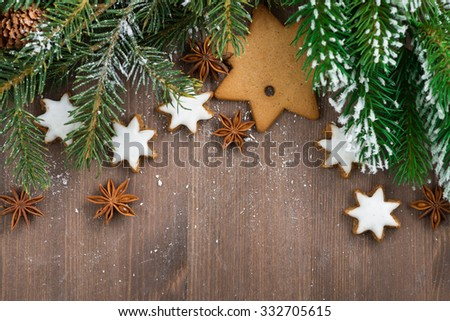 wooden background with fir branches and cookies, top view, horizontal, close-up - stock photo