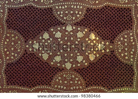 Wooden background with floral ornamental pattern and metall elements - stock photo