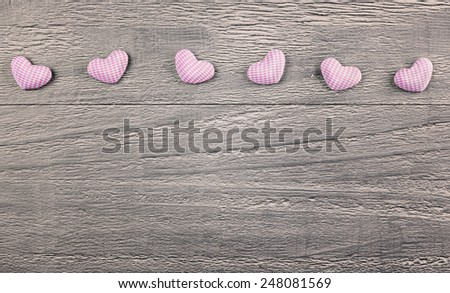 wooden background with gingham hearts toning in vintage style  - stock photo