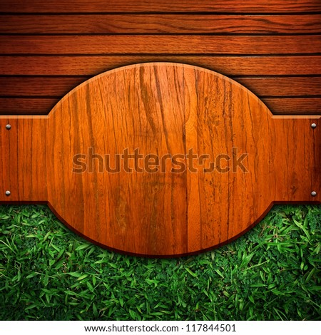 wooden background with grass - stock photo