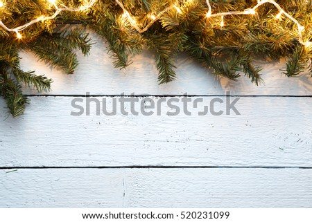 Wooden background with spruce branches for Christmas New Year holidays