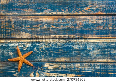 Wooden background with starfish - stock photo