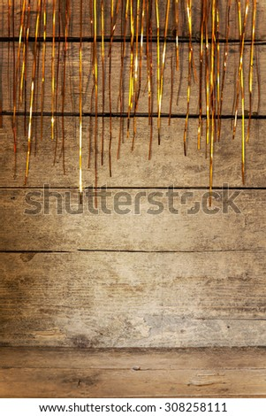wooden background with tinsel and golden shine - stock photo